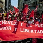 Supporters of Venezuelan President Chavez march to commemorate the 53rd anniversary of the country's democracy in Caracas