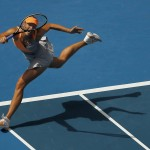 Sharapova of Russia hits a return to Goerges of Germany during their match at the Australian Open tennis tournament in Melbourne
