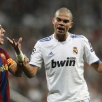 Real Madrid's Pepe argues with Barcelona's Puyol during their Champions League semi-final first leg soccer match in Madrid
