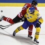 Kruger of Sweden blocks Eberle of Canada during their qualification round Group F game at the Ice Hockey World Championships in Kosice
