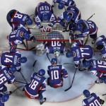 Slovakia's players huddle around their goaltender Halak befor the start of their qualifying round game against Denmark