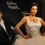 Celebrity blogger Perez Hilton poses next to the wax figure of TV personality Kim Kardashian at Madame Tussauds museum in Hollywood