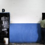 A police officer inspects cells at an unidentified prison in Caracas