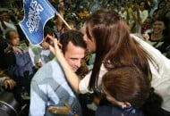 A supporter of Henrique Capriles Radonski, the governor of Miranda state, kisses him as he arrives at the launch of his presidential campaign in Caracas