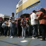 People line up to cast their votes at a polling station in Caracas