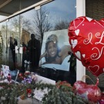 People leave flowers and balloons at the entrance of Whigham Funeral Home, in Newark, New Jersey