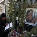 People write messages at the entrance of Whigham Funeral Home in Newark, New Jersey