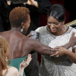 Octavia Spencer is congratulated by best actress nominee Viola Davis after Spencer won the award for Best Supporting Actress for the movie
