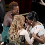 Octavia Spencer is congratulated by co-stars Chastain and Davis after she won the Oscar for Best Supporting Actress for her role in the