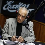 Reporter Bocaranda holds a cellular phone during his radio progam in Caracas