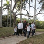 Venezuelan president Chavez walks with his family while recovering in La Habana