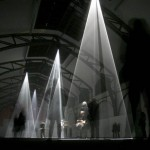 Visitors walk through light cones by British-born artist Anthony McCall during a preview of the exhibition