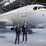 British artist Tracey Emin stands with designer Pascal Anson as they unveil British Airway's Olympic A319 aircraft