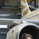 British artist Tracey Emin poses beside British Airway's Olympic A319 aircraft