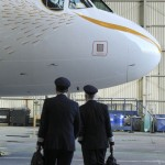 Pilots look at the British Airway's Olympic A319 aircraft