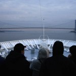Passengers aboard the Titanic Memorial Cruise ship MS Balmoral approach the Verrazano-Narrows Bridge while arriving in New York