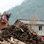 A Nepalese woman and her child collect firewood at Kabuche village near Pokhara, some 200 kms west of Kathmandu on May 10, 2012.  Over 80 percent of Nepal's 27 million population depends upon agriculture and paddy is the major crop in the Himalayan nation. AFP PHOTO/Prakash MATHEMA