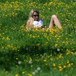 A woman enjoys a sunny day on May 1, 2012  at Petrin hill in Prague. AFP PHOTO/MICHAL CIZEK