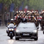 France's President Francois Hollande parades in a Citroen DS5 hybrid followed by the Republican guard on the Champs-Elysee avenue after being officially invested as France's president, on May 15, 2012 in Paris. AFP PHOTO / MARTIN BUREAU