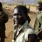A SPLA-N fighter stands near Gos village in the rebel-held territory of the Nuba Mountains in South Kordofan
