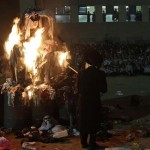 Rabbi David Gross lights a bonfire for Lag Ba-Omer in Ashdod