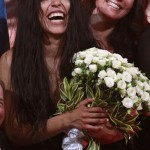 Loreen of Sweden holds flowers as she celebrates after winning the Eurovision song contest in Baku