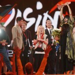 Loreen of Sweden lifts the trophy and flowers after winning the Eurovision song contest in Baku