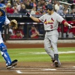 St. Louis Cardinals Carlos Beltran strikes out as New York Mets Josh Thole holds ball in MLB game in New York