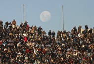 Soccer fans watch Uruguay play Venezuela in a World Cup qualifying soccer match in Montevideo