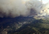 Plume of smoke rises from Waldo canyon wildfire in this aerial photograph taken in Colorado Springs Colorado