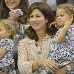 The wife of Roger Federer of Switzerland, Mirka Federer, with their twins, celebrates after Federer defeated Andy Murray of Britain in their men's singles final tennis match at the Wimbledon Tennis Championships in London