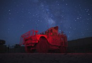 Milky Way shines in the sky behind a MRAP vehicle parked at the entry to FOB Goode near the town of Gardez in Afghanistan's Paktia Province