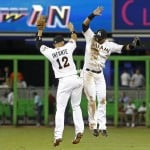 Miami Marlins' Infante celebrates with teammate Bonifacio after the Marlins defeated the Washington Nationals in their MLB baseball game in Miami