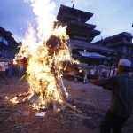 People set fire to an effigy of demon Ghantakarna to symbolize the destruction of evil while celebrating the Ghantakarna festival at Bhaktapur