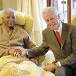 Former U.S. President Bill Clinton visits former South African President Nelson Mandela at his home in Qunu