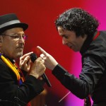 Venezuelan conductor Dudamel and Panamanian singer Blades perform during a concert in Caracas