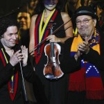 Venezuelan conductor Dudamel and Panamanian singer Blades acknowledge audience as they perform during a concert in Caracas