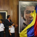 Venezuelan President Chavez unveils image of independence hero Bolivar during a ceremony in Caracas