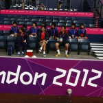 Members of the North Korean women's football team sit ahead of their Group G football match against Colombia at the London 2012 Olympic Games in Hampden Park, Glasgow, Scotland