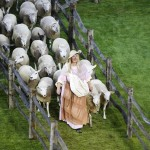 A performer walks in front of sheep before the opening ceremony of the London 2012 Olympics Games at the Olympic Stadium