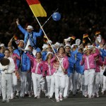 Germany's flag bearer Keller holds the national flag as she leads the contingent in the athletes parade during the opening ceremony of the London 2012 Olympic Games at the Olympic Stadium