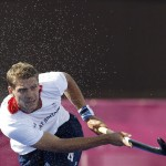 Britain's Smith hits the ball during their men's Group A hockey match against Pakistan at the London 2012 Olympic Games at the Riverbank Arena on the Olympic Park