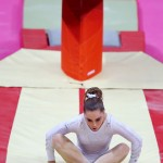 McKayla Maroney of the U.S. reacts after falling from the vault in the women's gymnastics vault final in the North Greenwich Arena