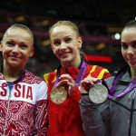 Silver medallist McKayla Maroney of the U.S. stands with gold medallist Sandra Raluca Izbasa of Romania and bronze medallist Maria Paseka of Russia at the women's vault victory ceremony in London
