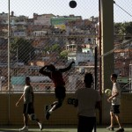Youths train at volleyball in the Complexo do Alemao slum in Rio de Janeiro