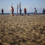 People play beach volleyball on Copacabana Beach in Rio de Janeiro