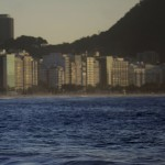 A swimmer wades into the sea at Copacabana Beach in Rio de Janeiro