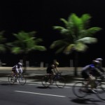 Cyclists ride their bikes in the seaside neighborhood of Ipanema in Rio de Janeiro