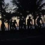 Cyclists ride in the seaside neighborhood of Ipanema in Rio de Janeiro