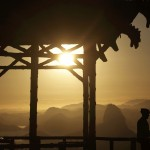 Cyclists take a break at the Vista Chinesa (Chinese View) as the sun rises in Rio de Janeiro